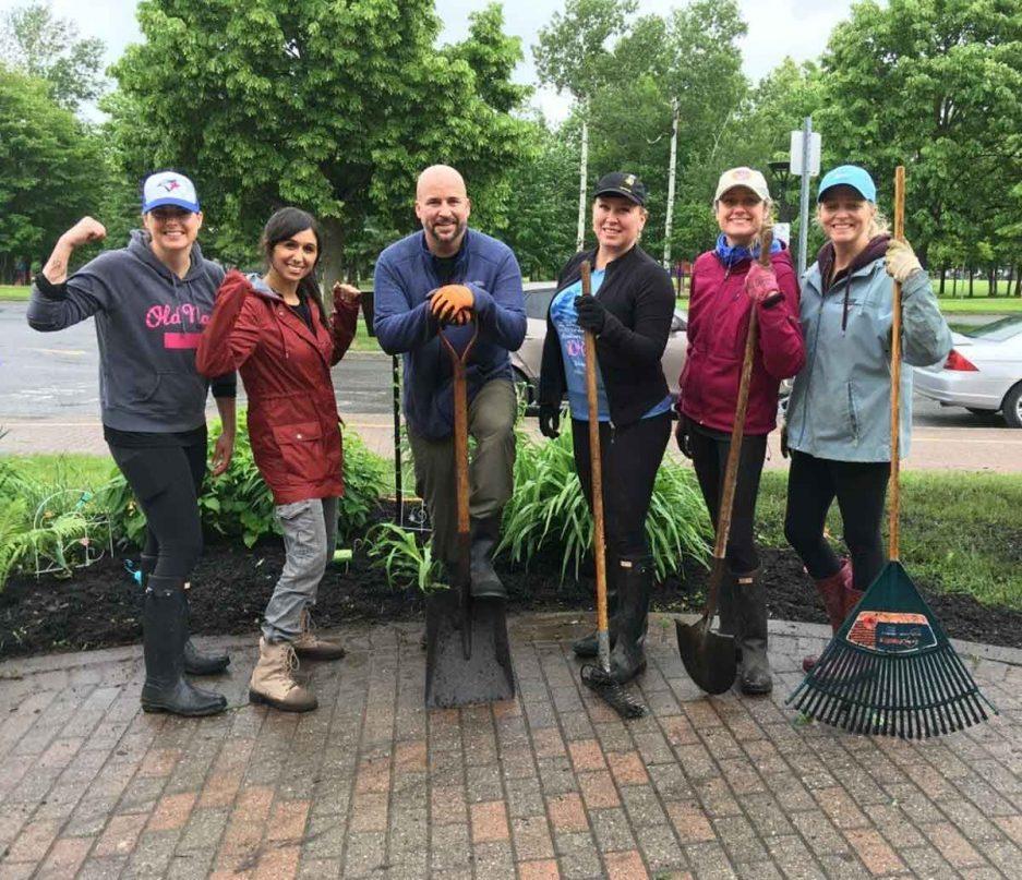 posed volunteers with rakes outside