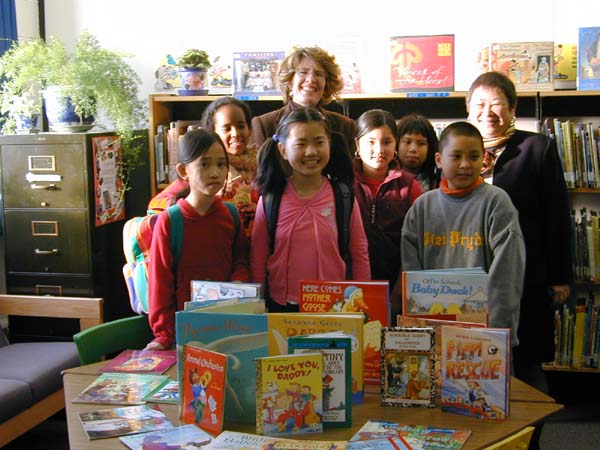 posed children with books and volunteers